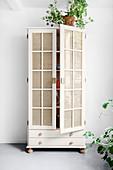 Refurbished cupboard with Viennese cane door panels