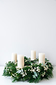 Advent wreath with white pillar candles