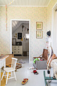 Rocking horse, old trunk and vintage accessories in child's bedroom