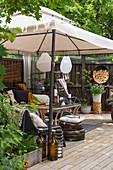 Comfortable, vintage-style seating area under pavillion on terrace