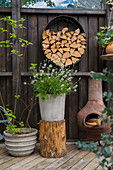 Planters, chiminea and round firewood rack on terrace