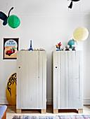 Two rustic board wardrobes in children's bedroom