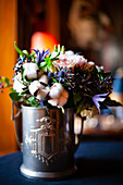 Bouquet with cotton bolls in silver tankard