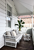 White rattan bench on American-style veranda