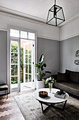 Two-tone wall in elegant living room in shades of grey