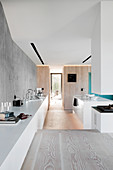 Sideboard in sunken, open-plan kitchen in architect-designed house