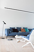 Blue, Scandinavian-style sofa in living room with wooden floor