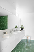 Green tiles with graphic pattern in modern bathroom