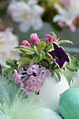 Mini-bouquet of lilac blossom, apple blossom and petunia in a duck egg as a vase