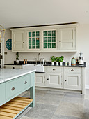 Cream country-house kitchen with pale blue island counter