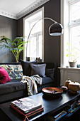 Classic, masculine living room in shades of grey in period building