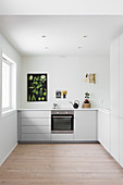 Botanical poster in white, minimalist kitchen