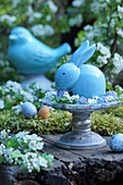 Ceramic Easter bunny in wreath of forget-me-nots