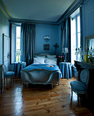 Antique fireplace and fireplace in blue bedroom