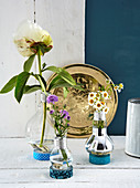 Vases made from old light bulbs in stands made from rolls of washi tape