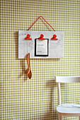 Handmade clipboard on kitchen wall