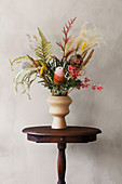 Bouquet of dried flowers on little old wooden table