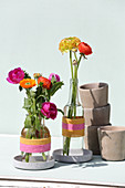 Glass bottles wrapped with woolen yarn used as vases
