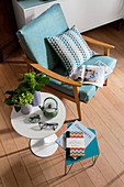 Pale blue fifties-style armchair and Tulip side table