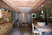 Rustic, wood-panelled farmhouse parlour with low ceiling