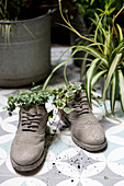 Shoes used as original planters on balcony