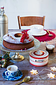Ring cake and butter dish on festively set table