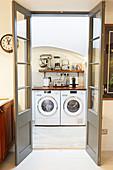 Washing machine and tumble dryer in kitchen