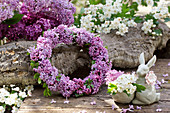 Wreath of lilac blossoms, Easter bunny egg cup with hawthorn blossoms
