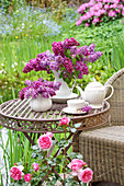 Lilac bouquets on table in the garden