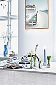 Flowering bulbs in glass jars decorating set table