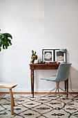 Antique desk and chair on Berber rug