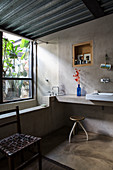Ensuite bathroom with concrete wall and metal ceiling