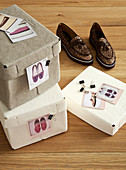 Shoeboxes labelled with clipped-on photos: organisation and storage idea