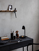Black desk with masculine vintage accessories