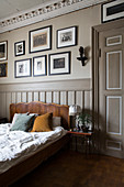 Panelled door, wainscoting and stucco ceiling in bedroom