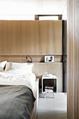 Niche shelf in bedroom wall panelling