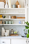 Accessories in natural shades on kitchen shelves
