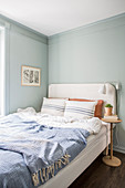 French bed in bedroom with grey-blue walls