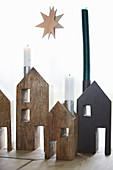 Christmas decorations: Wooden houses with candle-holder chimneys