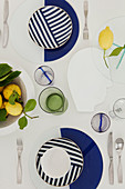 Table set with blue-and-white crockery decorated with lemons