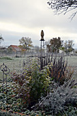 Trellis in the late autumn shrub bed with hoarfrost