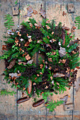 Wreath of spruce branches, thuja and dried hydrangea flowers