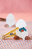 Easter egg decoration that opens to reveal chick made from clothes peg
