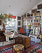 Bookcase in eclectic living room with ethnic patterns