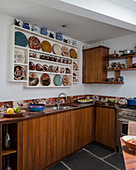 Collection of plates on plate rack in retro kitchen