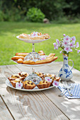 French pastries on DIY cake stand made from glasses and plates