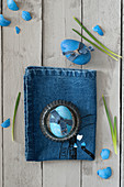 Blue Easter egg decorated with denim ribbon