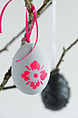Grey Easter eggs with neon flower motifs