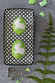 Green Easter eggs with Easter bunny motifs