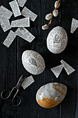 Blown eggs with newspaper decoupage and marbled egg